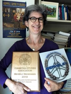 Beverly Seckinger displays two awards received by Hippie Family Values Oct 2019